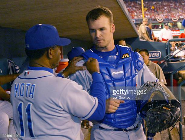 Los Angeles Dodgers coach Manny Mota advises catcher David Ross prior to game vs St Louis Cardinals Thursday October 7 2004 at Busch Stadium in...