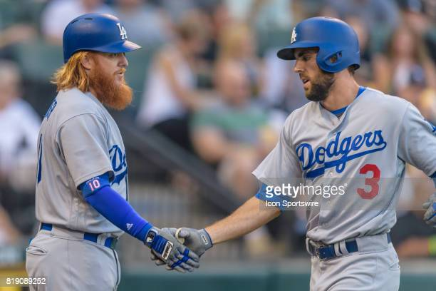 Los Angeles Dodgers designated hitter Justin Turner congratulates Los Angeles Dodgers left fielder Chris Taylor on a solo home run in the 1st inning...