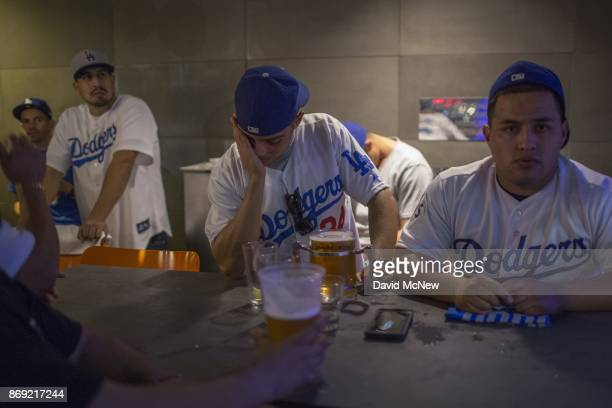 Los Angeles Dodgers fans react as the Houston Astros dominate the Los Angeles Dodgers in the final game of the World Series to take the championship...