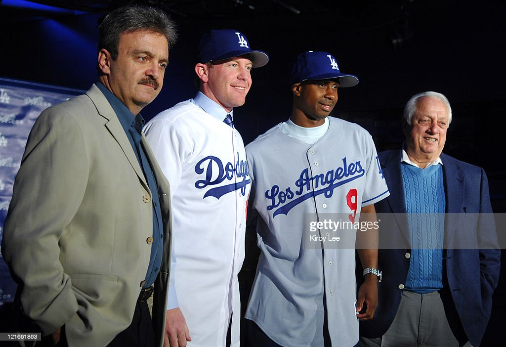 Los Angeles Dodgers General Manager Ned Colletti Randy Wolf Juan Pierre and Tommy Lasorda at press conference to announce the contract signings of...