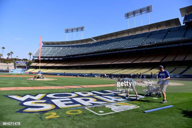 Los Angeles Dodgers grounds crew Jordan Lorenz and Justin Patenaude paint the World Series logo on to the field in preparation for game one and two...