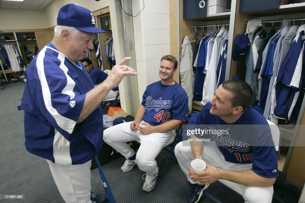 Los Angeles Dodgers Hall of Fame Manager Tom Lasorda(L) speaks to Dodger catchers <a gi-track='captionPersonalityLinkClicked' href=/galleries/search?phrase=David+Ross+-+Baseball+Player&family=editorial&specificpeople=210843 ng-click='$event.stopPropagation()'>David Ross</a> and Paul Bako (R) during the first day of workouts at Dodgertown in Vero Beach, Florida Saturday February 19, 2005.