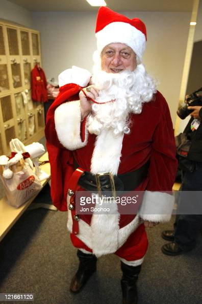 Los Angeles Dodgers Hall of Fame Manager Tommy Lasorda is Santa Claus during his visit to the Kids Christmas party at the Mattel Childrens Hospital...