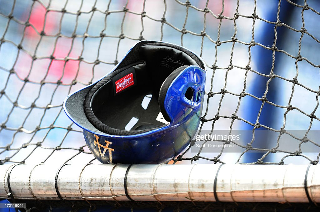 A Los Angeles Dodgers helmet rests on the batting cage before the game against the Atlanta Braves at Turner Field on May 17, 2013 in Atlanta, Georgia.