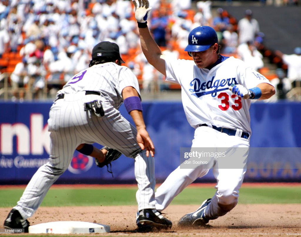 Los Angeles Dodgers Jason Grabowski is tagged out by Colorado Rockies Vinny Castilla in Los Angeles California on July 22 2004