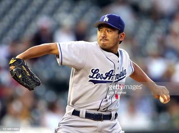 Los Angeles Dodgers Kazuhisa Ishii gives up a home run to Colorado Rockies Todd Helton in the third inning at Coors Field in Denver Colorado on July...