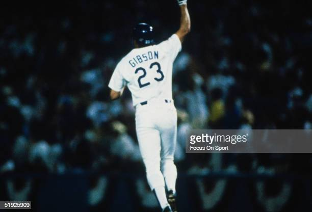 Los Angeles Dodgers' Kirk Gibson gestures to the crowd after hitting a home run against the Oakland Athletics during the World Series at Dodger...