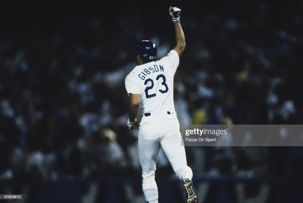 Los Angeles Dodgers' Kirk Gibson gestures to the crowd after hitting a home run during the World Series against the Oakland Athletics at Dodger...