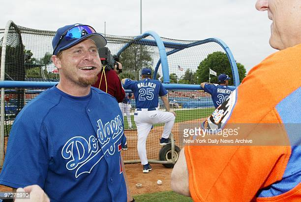 Los Angeles Dodgers' left fielder Jeremy Giambi pauses for a chat with the opposition before a game against the New York Mets at Vero Beach Fla The...