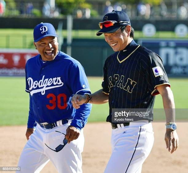 Los Angeles Dodgers manager Dave Roberts and Hiroki Kokubo manager of Japan's World Baseball Classic team chat after their exhibition game in...