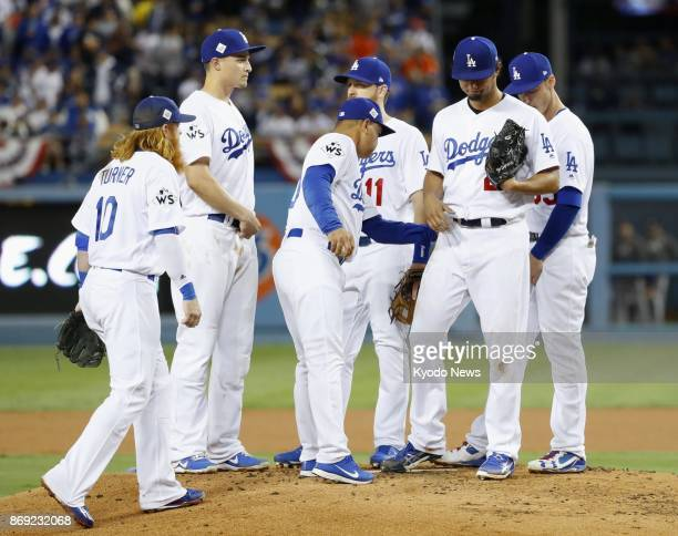 Los Angeles Dodgers manager Dave Roberts pulls starting pitcher Yu Darvish during the second inning in Game 7 of the World Series against the Houston...
