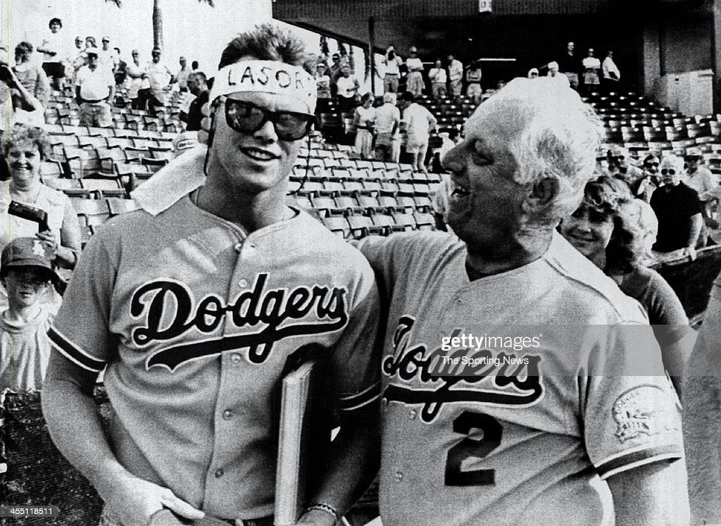Los Angeles Dodgers manager <a gi-track='captionPersonalityLinkClicked' href=/galleries/search?phrase=Tommy+Lasorda&family=editorial&specificpeople=206834 ng-click='$event.stopPropagation()'>Tommy Lasorda</a> ties a headband onto Chicago Bears quarterback <a gi-track='captionPersonalityLinkClicked' href=/galleries/search?phrase=Jim+McMahon+-+American+Football+Player&family=editorial&specificpeople=228299 ng-click='$event.stopPropagation()'>Jim McMahon</a> March 4, 1987 at Dodgertown in Vero Beach, Florida. McMahon visited Dodgertown for a checkup with Dr. Frank Jobe, who performed the surgery on his shoulder. Lasorda managed the Dodgers from 1976-1996.
