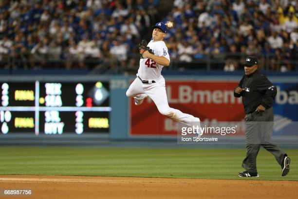 Los Angeles Dodgers Outfield Enrique Hernandez makes a throw to first base against the Arizona Diamondbacks on April 15 during Jackie Robinson Day at...