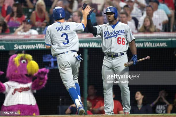 Los Angeles Dodgers outfielder Chris Taylor is congratulated by Los Angeles Dodgers right fielder Yasiel Puig after scoring on a throwing error by...