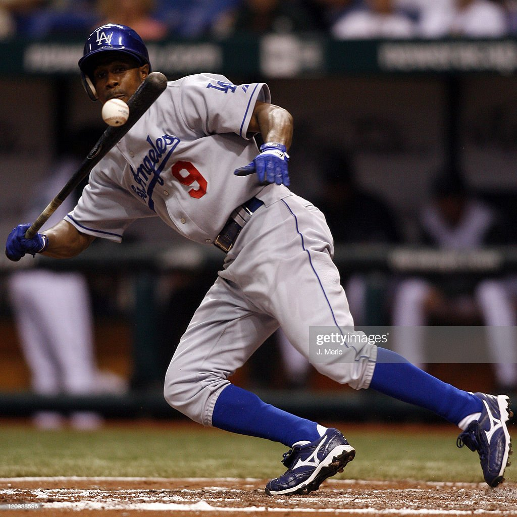Los Angeles Dodgers outfielder <a gi-track='captionPersonalityLinkClicked' href=/galleries/search?phrase=Juan+Pierre&family=editorial&specificpeople=202961 ng-click='$event.stopPropagation()'>Juan Pierre</a> attempts a bunt against the Tampa Bay Devil Rays on Friday night at Tropicana Field in St. Petersburg, Florida on June 22, 2007.