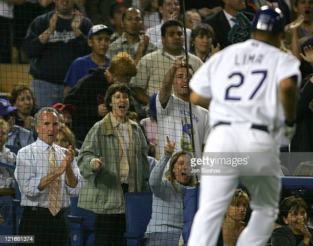 Los Angeles Dodgers owner Frank McCourt cheers for pitcher Jose Lima after squeezing in a run in the seventh inning of the game against the Arizona...