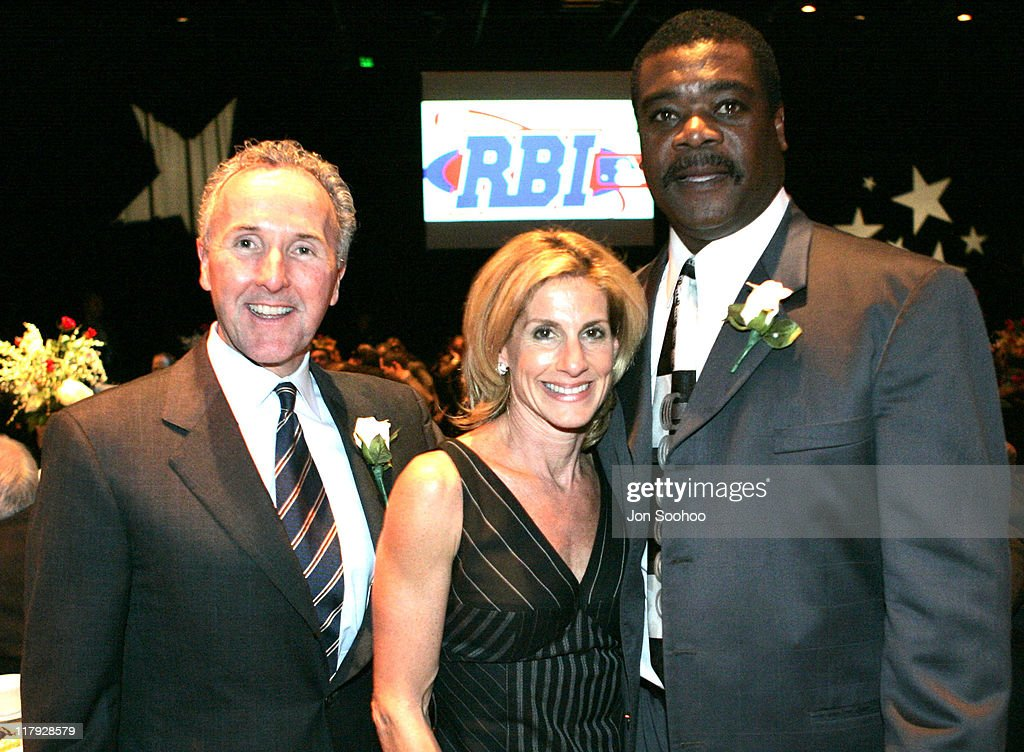 Los Angeles Dodgers owner Frank McCourt, wife Jamie McCourt and Hall of Fame slugger <a gi-track='captionPersonalityLinkClicked' href=/galleries/search?phrase=Eddie+Murray&family=editorial&specificpeople=210573 ng-click='$event.stopPropagation()'>Eddie Murray</a> pose together during the RBI Dinner at the Globe Theatre, Universal Studios Hollywood Theme Park. Reviving Baseball in Inner Cities Hall of Fame Dinner held Wednesday, February 9, 2005 in Los Angeles, California.