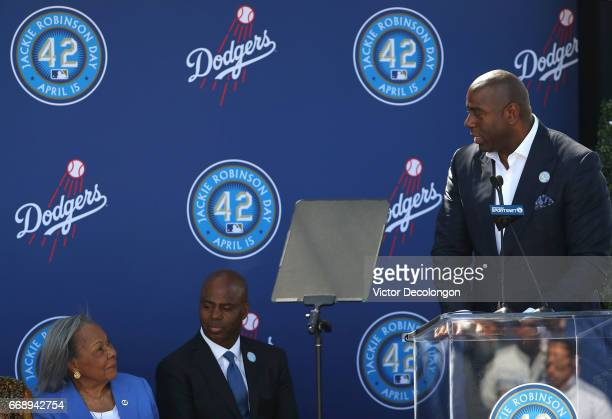 Los Angeles Dodgers owner Magic Johnson speaks onstage as Rachel Robinson left and Kevin Frazier look on during the Los Angeles Dodgers Jackie...