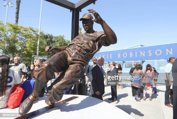 Los Angeles Dodgers owner Stan Kasten looks on next to the Jackie Robinson Statue at Dodger Stadium on April 15 2017 in Los Angeles California