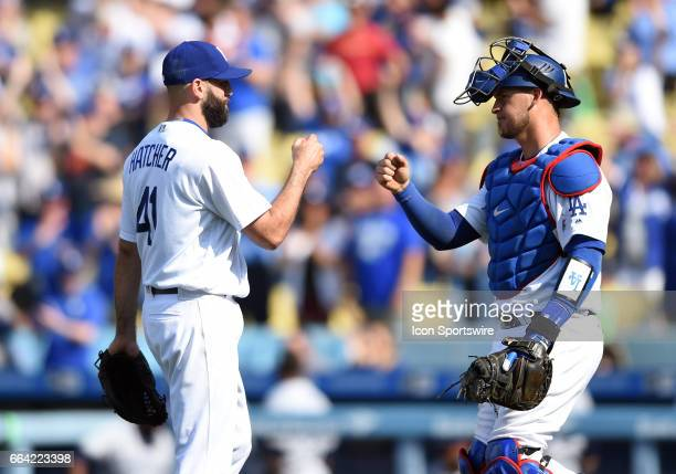 Los Angeles Dodgers Pitcher Chris Hatcher celebrates the victory with Los Angeles Dodgers Catcher Yasmani Grandal during an MLB opening day game...