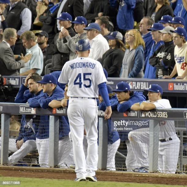 Los Angeles Dodgers pitcher Yu Darvish and his teammates watch as the Houston Astros celebrate winning the World Series at Dodger Stadium in Los...
