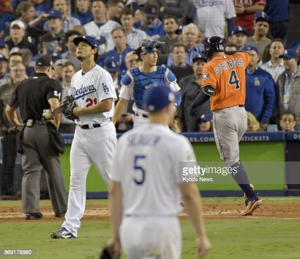 Los Angeles Dodgers pitcher Yu Darvish is pictured after allowing a tworun homer to George Springer of the Houston Astros in the second inning in...