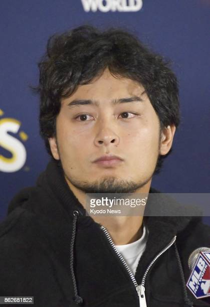 Los Angeles Dodgers pitcher Yu Darvish listens to a question from a reporter after starting Game 3 of the National League Championship Series against...