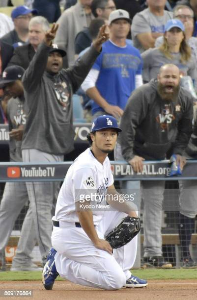 Los Angeles Dodgers pitcher Yu Darvish reacts after allowing the Houston Astros to take a quick 10 lead in the first inning in Game 7 of the World...