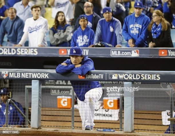 Los Angeles Dodgers pitcher Yu Darvish watches as the Houston Astros celebrate winning the World Series at Dodger Stadium in Los Angeles on Nov 1...