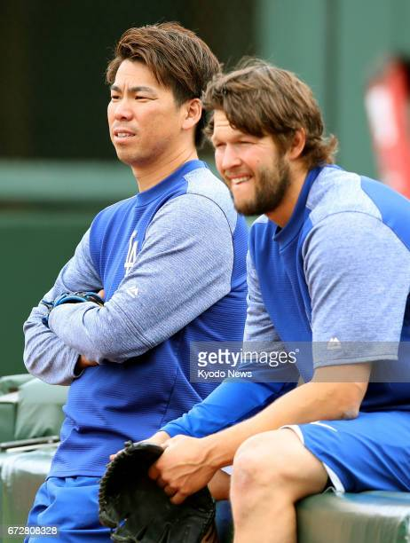 Los Angeles Dodgers pitchers Clayton Kershaw and Kenta Maeda watch a teammate warm up for a game against the San Francisco Giants at ATampT Park in...