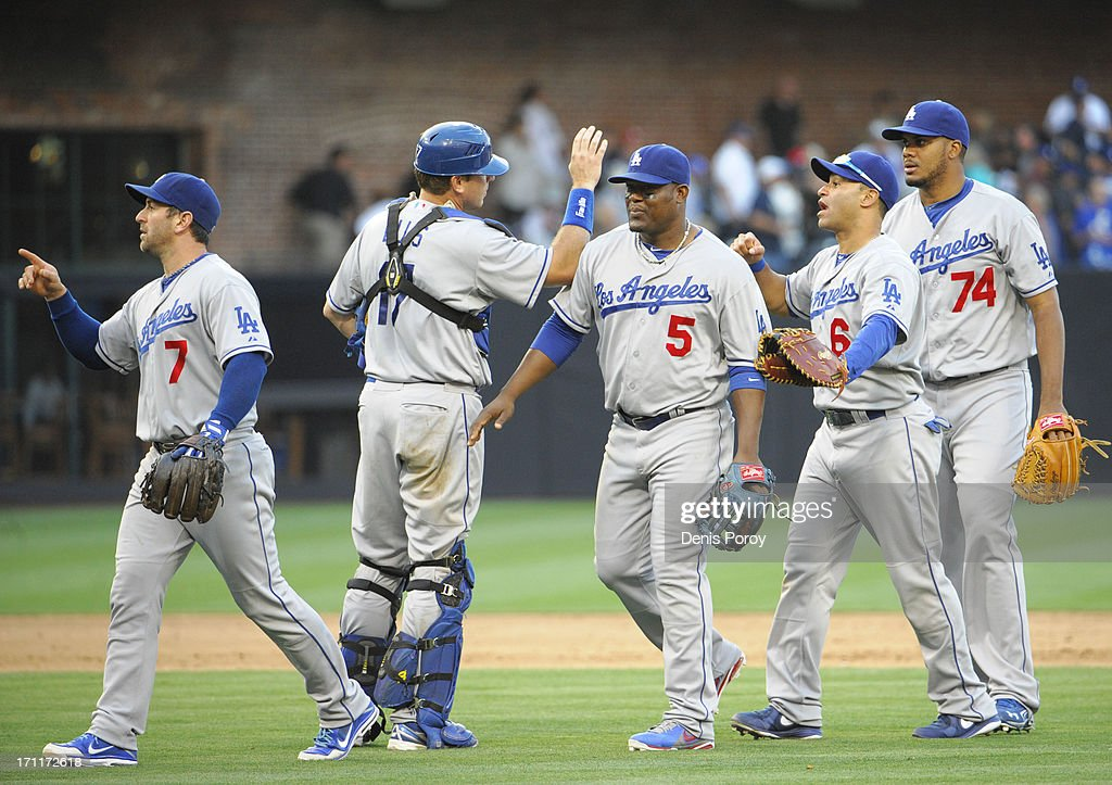 Los Angeles Dodgers players high-five after beating the San Diego Padres 6-1 in a baseball game at Petco Park on June 22, 2013 in San Diego, California.