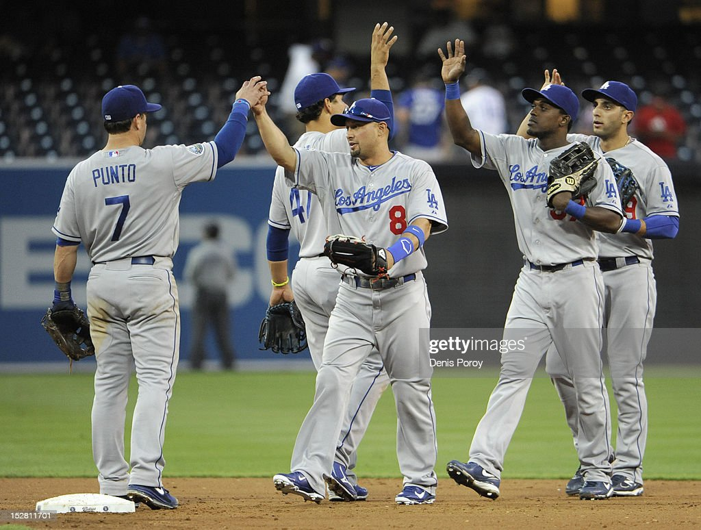 Los Angeles Dodgers players high-five after beating the San Diego Padres 8-2 in a baseball game at Petco Park on September 26, 2012 in San Diego, California.