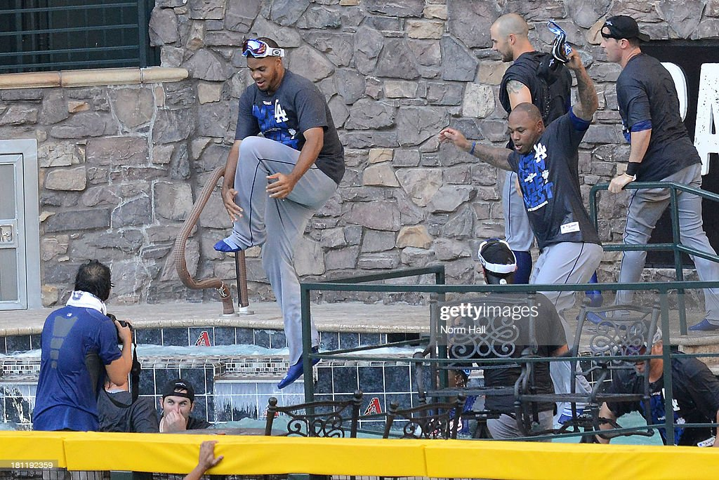 Los Angeles Dodgers players jump in the pool after clinching the National League West after a 7-6 win against the Arizona Diamondbacks at Chase Field on September 19, 2013 in Phoenix, Arizona.