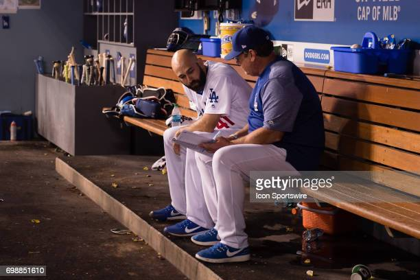 Los Angeles Dodgers relief pitcher Chris Hatcher sits in the dugout and reviews game notes during the game between the New York Mets and the Los...
