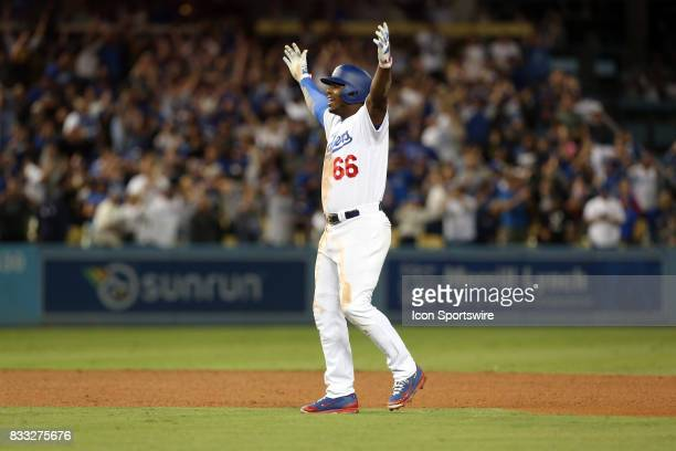 Los Angeles Dodgers right fielder Yasiel Puig celebrates after hitting a walk off double during the game defeating the Chicago White Sox 54 on August...