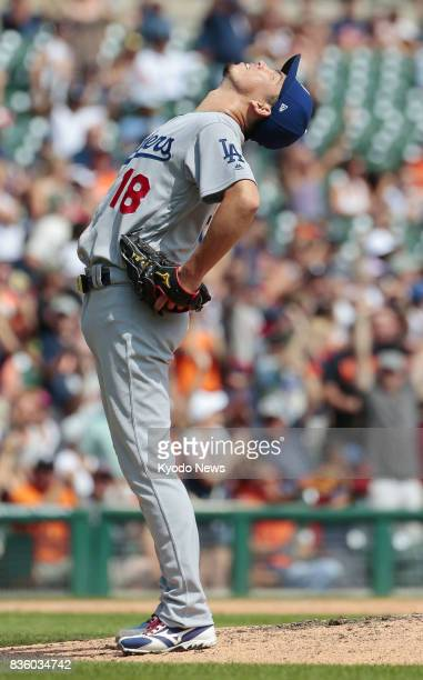 Los Angeles Dodgers righthander Kenta Maeda reacts after giving up a tworun homer to Detroit Tigers' Justin Upton in the bottom of the sixth inning...