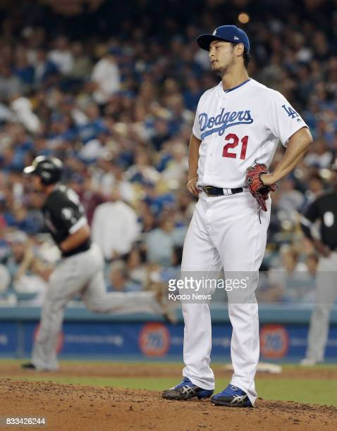 Los Angeles Dodgers righthander Yu Darvish reacts after allowing a third homer of the game on this occasion to Jose Abreu of the Chicago White Sox in...