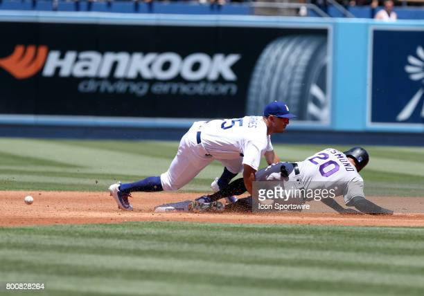 Los Angeles Dodgers second baseman Austin Barnes attempts to tag out Colorado Rockies outfielder Ian Desmond during the game on June 25 at Dodger...
