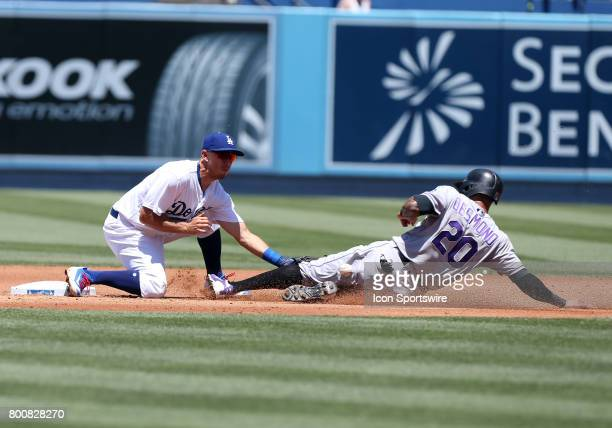 Los Angeles Dodgers second baseman Austin Barnes attempts to tag out Colorado Rockies Outfield Ian Desmond during the game on June 25 at Dodger...