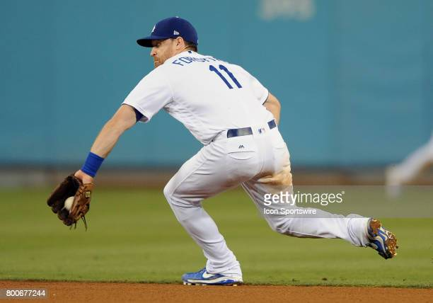 Los Angeles Dodgers second baseman Logan Forsythe fields a ground ball in the eighth inning of a game against the Colorado Rockies on June 24 played...