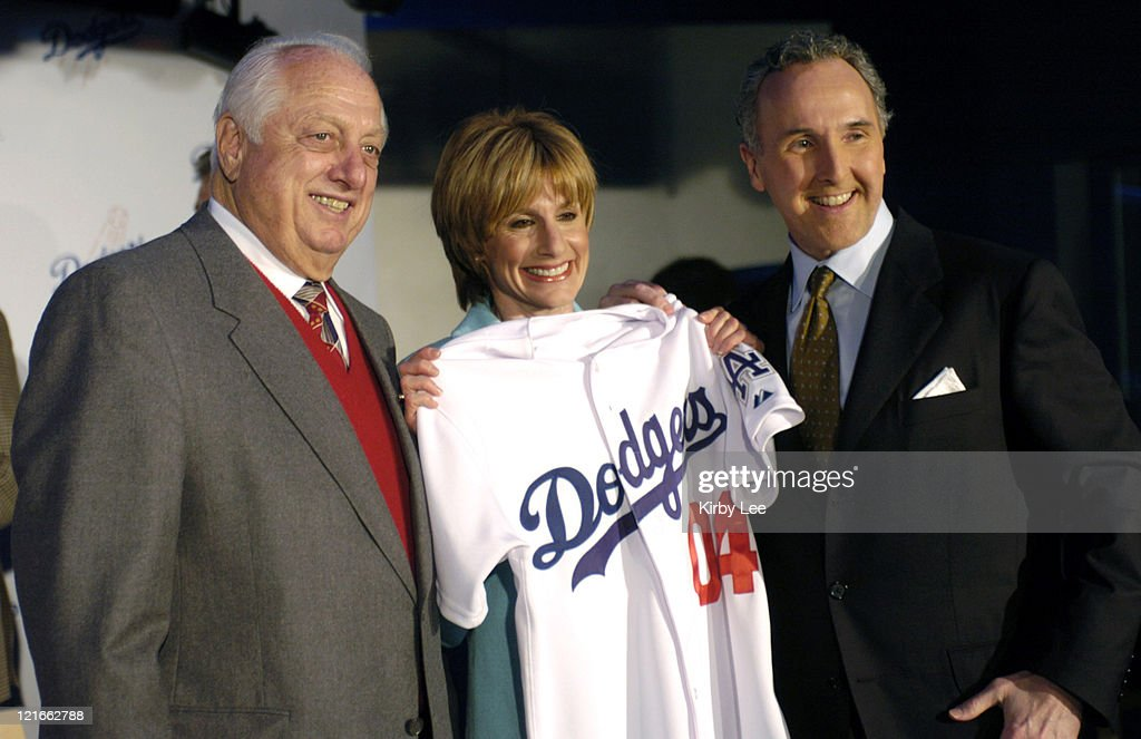 Los Angeles Dodgers senior vice president Tommy Lasorda poses with new owners Jamie and Frank McCourt at press conference announcing McCourts'...