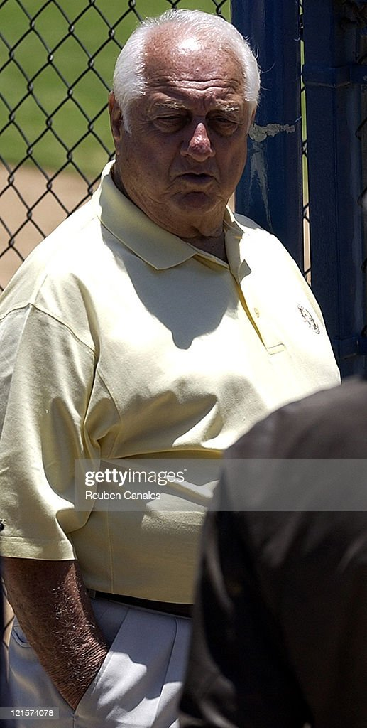 Los Angeles Dodgers Special Advisor to the Chairman Tommy Lasorda watches as the California State UniversityFullerton Titans deafeated the Long Beach...