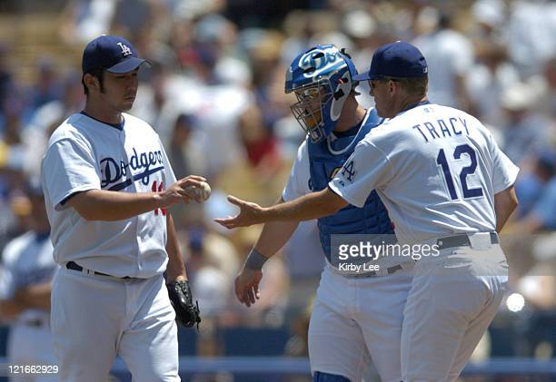 Los Angeles Dodgers starter Hideo Nomo is removed by manager Jim Tracy in the second inning against the Chicago Cubs at Dodger Stadium in Los Angeles...