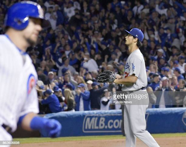 Los Angeles Dodgers starter Yu Darvish gives up a home run to the Chicago Cubs' Kyle Schwarber in the first inning of Game 3 of the National League...