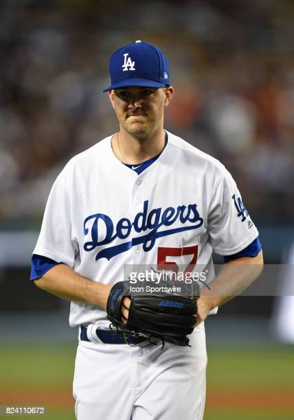 Los Angeles Dodgers starting pitcher Alex Wood walks off the field in the fourth inning with an angry face after a controversial call by the umpire...
