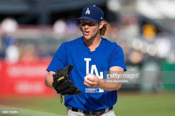 Los Angeles Dodgers Starting pitcher Clayton Kershaw jokes with a fan during a game between the Los Angeles Dodgers and the Pittsburgh Pirates on...