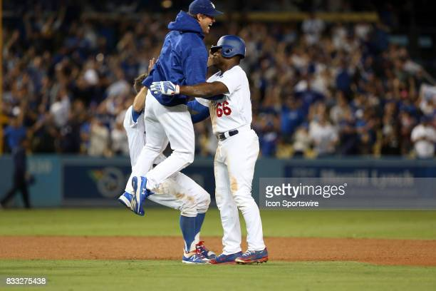 Los Angeles Dodgers starting pitcher Clayton Kershaw jumps in to Los Angeles Dodgers right fielder Yasiel Puig after Puig hits a walk off double...