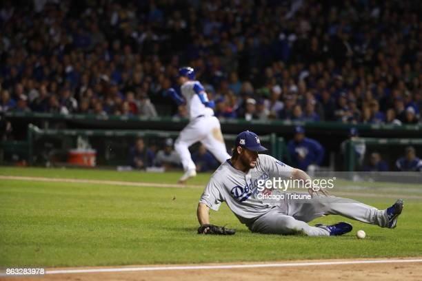 Los Angeles Dodgers starting pitcher Clayton Kershaw tries to field a bunt by the Chicago Cubs' Kyle Schwarber in the sixth inning in Game 5 of the...