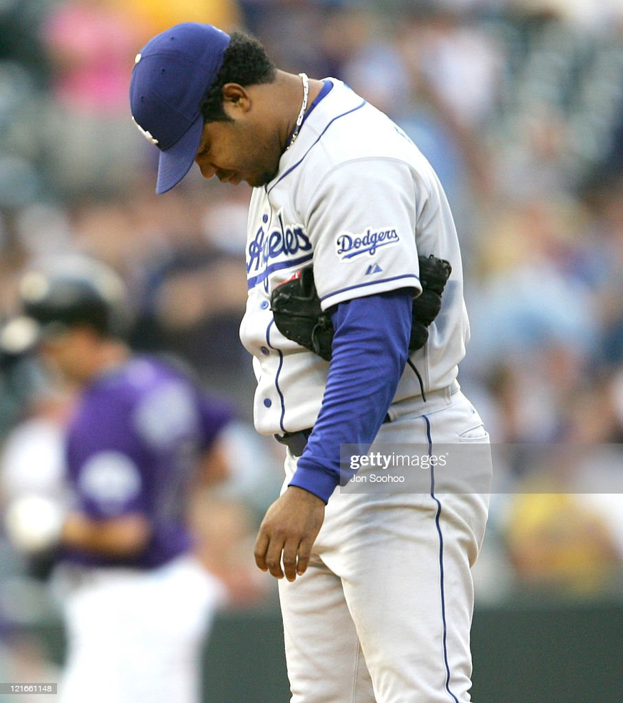 Los Angeles Dodgers starting pitcher <a gi-track='captionPersonalityLinkClicked' href=/galleries/search?phrase=Odalis+Perez&family=editorial&specificpeople=176554 ng-click='$event.stopPropagation()'>Odalis Perez</a> grimaces after giving up first inning home run to Colorado Rockies <a gi-track='captionPersonalityLinkClicked' href=/galleries/search?phrase=Todd+Helton&family=editorial&specificpeople=200735 ng-click='$event.stopPropagation()'>Todd Helton</a> at Coors Field in Denver, Colorado on July 27, 2004.