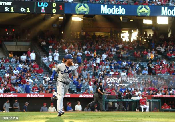 Los Angeles Dodgers Third base Justin Turner runs to first after connecting with the ball during a Major League Baseball game between the Los Angeles...